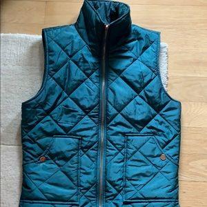 Dark green tufted vest